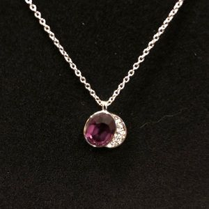 Purple stone with sparkle pendant.